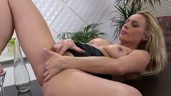 Sizzling whore Brittany Bardot likes to demolish her pussy with the giant dildo