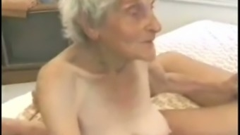 Really old white woman with zero titties entertaining a dick