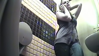 Blondhead discussions on the cell phone within the potty and pisses on secret cam video files