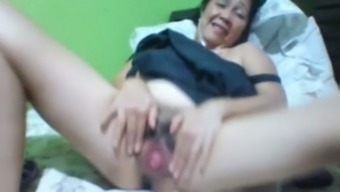 Filipina oily along with dark hair and deflated substantial boobs masturbates herself