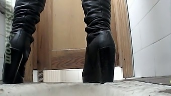 White colored lady in matchless leather boots pisses within the bathroom create space on cam