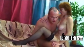 Big tits granny twiddling with excess weight cock