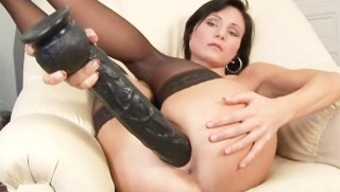 Paola gets filled her snatch with a vast dildo