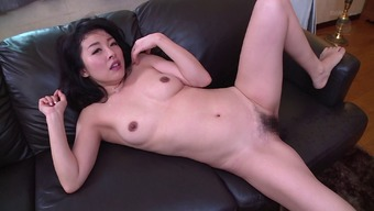 Attractive Far eastern homemaker gets her hirsuite pussy drilled in the cooking area