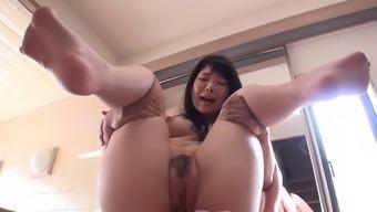 Far eastern vagabond along with natural boobs gives a blowjob and titjob