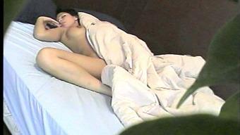 Wayward brunette by using beautiful organic titties entertaining her pussy on her sleep