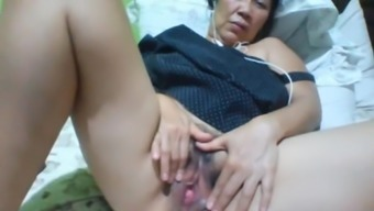Filipino granny 58 fucking me dull on cam. (Manila)one(1)