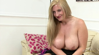 Lively Milf rubs her clit and plays back with her enormous boobs!