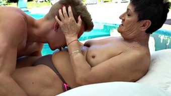Granny chows down on a young man's cum