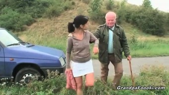 Gorgeous babe seduces grand father driving