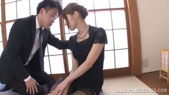 Japanese mama dressing stockings enjoys a few kinky bowling