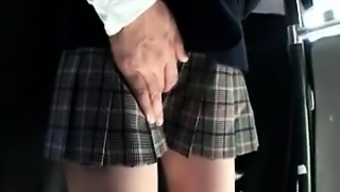 Adorable Oriental schoolgirl consists of a attractive man touching her puss