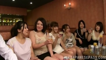 At a club a grouping of Japanese people women has panel sex along with weird males