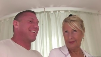 Mature blonde Dillon A is creampied by a stud poker after displayed her large tits