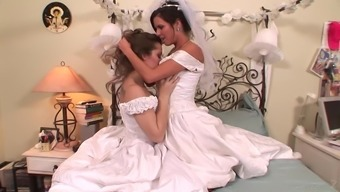 A soon to be bride has lesbian love-making with the maid of follow on top of her wedding