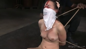 Pretty young adult within the polka accentuate gown displays through sexy bondage