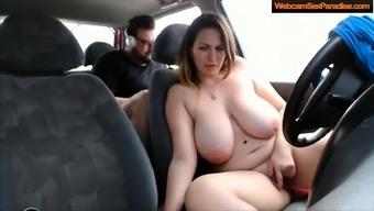 Girl along with major titties masturbates inside a auto