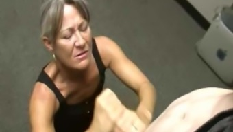 Mature bosslady facialized after wanking young adult