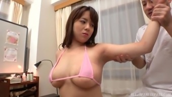 Busty Mishima Natsuko allow a pal to play with her tits