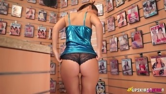 The english language slutty stripper Jess West exposes her legs and nice bum