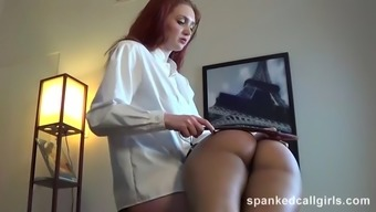 Hot redhead spanks her moaner