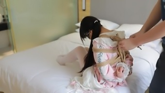 Cute chinese being bound taped hands