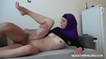 Slut wearing hijab banged on couch