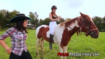 One lucky dude fucks two seductive country chicks right in the field