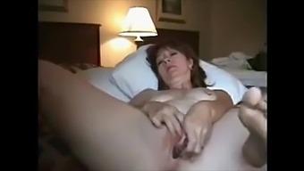 Mature wife masturbating to reach orgasm