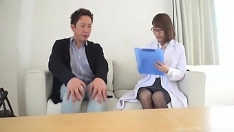 Approachable Japanese lady doctor helps out a male patient in need