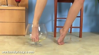 Cute girl with foot fetish enjoys pissing while masturbating
