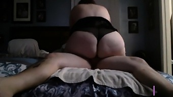 Girl rides hubby hard to a quick orgasm