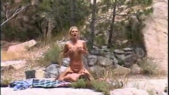 Blonde bimbo Alexis Malone has her pussy drilled outdoors
