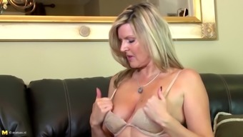 Amazing amateur grow older woman on a leather covered tub chair sofa