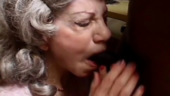 Naughty granny blows dark colored lift with excitement