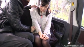 Checking out her Japanese beaver right there on the back seat