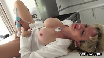 Adulterous english language milf lady sonia demonstrates her colossal boobs
