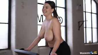 Sporty raven haired moaner Scarlet Blush smoothies her luscious boobs whereas using fitness system