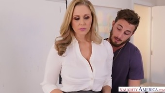 Yummy busty milf Julia Ann is fucked in the middle of the costs by Johhny Stack