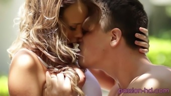 Alexis Adams moaning on top of her naked partner from pleasure